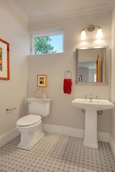 Traditional Powder Room with Powder room, penny tile floors, Pedestal sink, specialty door