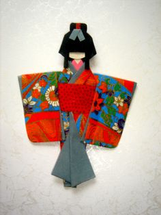 Little origami doll, via Flickr.