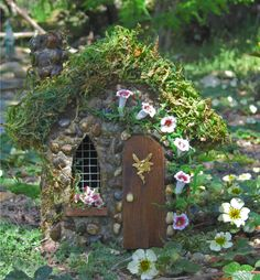 An enchanted miniature flower fairy house to decorate your miniature fairy gardens.