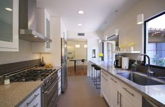 In this galley kitchen, the countertop was extended in front of a window, creating a lovely breakfast bar.