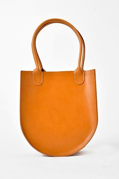 196958e8cf1b0 English Bridle leather tote from Sara Barner. Single interior pocket. Hand  stitched rolled handles