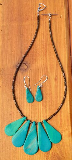 457445393 Polymer clay necklace and earrings with metallic opaque bronze seed beads.