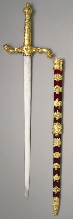 Britain's Sword of State, 1678-98; 'The wooden scabbard is covered in velvet with applied silver-gilt emblems including a rose, thistle, harp and fleur-de-lis, with a portcullis, royal lions and the coat of arms of William III'. (Royal Collection Trust)