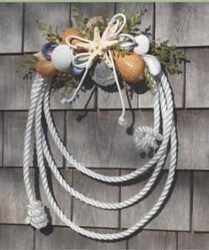 Nautical Rope Shell Wreath; perfect for a retirement home on the beach! Mama Ware I can see you loving this and incorporating it into all of your beach decorations!