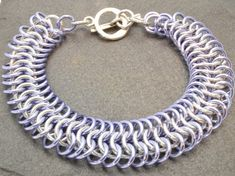 This is a beautiful color to add to your stack of bracelets! A light purple described as lavender, surrounds the center silver colored ring . European 4 in 1 is one of the most common chainmaille weaves and has numerous variations. It is the pattern seen in armor worn by knights in the