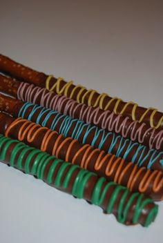 """Chocolate covered pretzels. Used red candy melts on small circle pretzels- """"Mini Mars"""""""