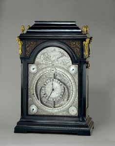Astronomical calendar clock; eight-day movement with two trains, for going and striking, both with fusee; dead beat escapement with inverted crutch piece, pendulum suspended from vertical steel loop; striking-train with inside count-wheel; back plate engraved with foliate border, scrolling foliage, birds and a mask; dial constructed from several fixed sections of brass and copper, with idle subsidiary corner dials and a nest of rings at centre, some rotating, some fixed; give multiple ...