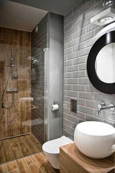 déco salle de bain zen, vasque blanche, carrelage gris métro, cabine de douche en bois, miroir rond à l'encadrement noir