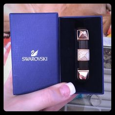 Swarovski Leather Rose Gold Bracelet In excellent condition! Only worn twice and has no flaws! Approximate size: 7 inches. Purchased directly from Swarovski and comes with Swarovski protective box. No trades. No PayPal! Swarovski Jewelry Bracelets