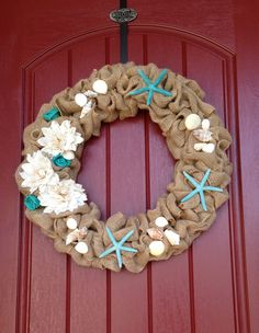 Seashell wreath for summer.  Just made it.  So easy, I love burlap.  Everything from Hobby Lobby.
