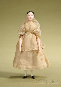 Early china doll with wood body, 8 1/2""