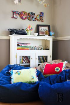 Kids room ideas.  Definitely need a bean bag in their rooms...along with a cute place for their books!