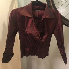 Dark red fitted blouse with collar. Back zip.small Shiny dark red blouse.  Looks best with black (velvet) skirt KM collection  Tops Blouses