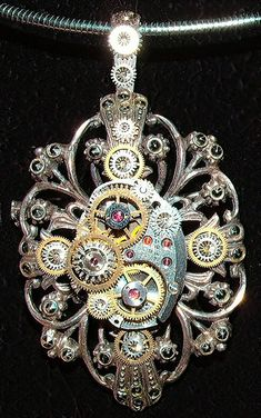"This is my first Steampunk creation - but not my last. I created this from a partially intact vintage ladies watch movement and a box full of cogs, gears and old watch pieces.   It took a  few tools, some Amazing Goop glue, and a whole lot of patience; but I think the watch part assemblage was worth all the effort in the end. I'm glad I had some extra watch part rubies in my mix since they made the piece ""pop"".  I will wear it as a way to ""fly my Steampunk flag"".  To see more on this visit my blog post about it at  ekduncan.blogspot.com/2010/08/my-first-steampunk-creation..."