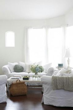 beautiful (though not realistic with kids) living room   Love the white slipcovers.
