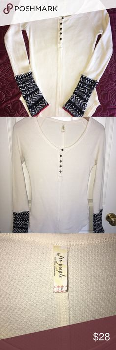Free People cream Henley Top SizeSmall, boarder detail sleeves. Perfect condition! Cream color with black and red detailed sleeves. Free People Tops Tees - Long Sleeve