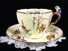 I would love to drink tea out of this every morning. Parrot Handled Grafton Teacup and Saucer, Rare BAJ & Sons Tea Cup, Made in England China Cups And Saucers, China Tea Cups, Teapots And Cups, Cup And Saucer Set, Tea Cup Saucer, Antique Tea Cups, Vintage Teacups, My Cup Of Tea, Drinking Tea