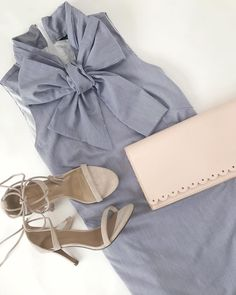 Put a bow on it. We especially like the big, beautiful bow on this chic frock in crisp cotton. Add a bit of magic— an innovative phone charging clutch and some strappy sandals and you you are ready for wherever the day (and night) takes you.