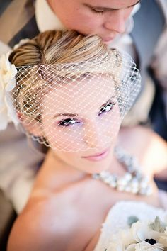 Bird cage bridal veils are such a cute trend! Very timeless look www.dreambridalboutique.com