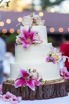 Love Birds on top of cake with Flowers.