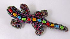 Cute large gecko lizard glass seed bead brooch pin. This darling lizard has lots of sparkle and great detail, a row of 12 brightly colored glass beads along his back really make this piece pop! Be sure to see the other seed bead pin creations we have listed this week. | eBay!