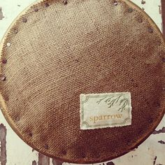 my mom made this adorable cover for a footstool! #handmade #craft #sparrow #burlap #diy
