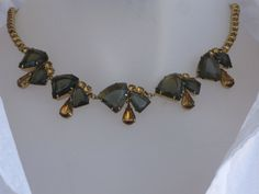 Vintage choker: clear green-brown and gold glass set on gold metal settings. Original box with matching earrings. mizmlu on Etsy, $54.97