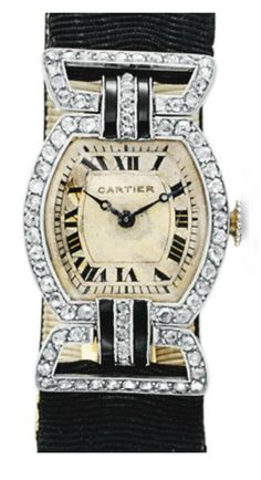 AN ART DECO DIAMOND AND ONYX WRISTWATCH, BY CARTIER   With nickel-finished lever movement, bi-metallic compensation balance, 19 jewels, the tonneau-shaped silver matte dial with black Roman numerals and blued-steel hands, within a rose-cut diamond bezel, joined by onyx and rose-cut diamond links to the black silk strap, mounted in platinum and gold, circa 1925, 5¾ ins., with French assay marks and maker's marks, black silk strap may be of later addition  Signed Cartier