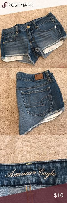 American eagle jean shorts size 6 American eagle jeans shorts with pockets that hang down with silver glitter stars Shorts Jean Shorts