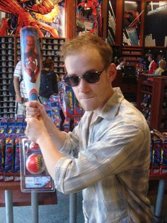 Joe Moses with a tiny Spiderman baseball bat... Gotta love him.