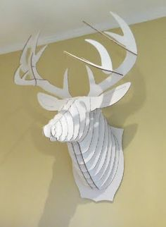 White Cardboard Deer Head...colton probably wouldn't like it but it would be kinda cool to have quests write on the pieces and then put it all together after the wedding