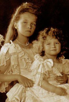 Their Imperial Highnesses The Grand Duchesses Olga Nikolaevna Romanova, and Tsarevich Alexei Nikolaevich Romanov of Russia, 1906.