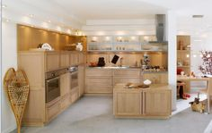 White Wall Cabinet With Frosted Glass Doors And Mini Recessed Lighting Plus Wood Backsplash Ideas In Natural Kitchen Design