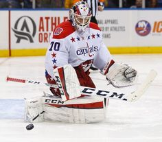 Washington Capitals goalie Braden Holtby (70) blocks a shot in overtime of Game 4 of a first-round NHL Stanley Cup hockey playoff series at Nassau Coliseum in Uniondale, N.Y., Tuesday, April 21, 2015. The Capitals defeated the Islanders 2-1 to even their series at 2-2. (AP Photo/Kathy Willens)