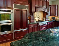 More red cabinets, verde granite Red Cabinets, Cherry Cabinets, Kitchen Remodeling, Remodeling Ideas, Green Countertops, Interior Ideas, Interior Design, Raised Panel Doors, Green Marble