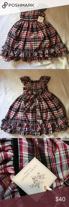 Gorgeous Laura Ashley London dress. Girls 6. NWT Brand new Laura Ashley London plaid dress with ruffle details on cap sleeves and on the bottom. Empire waist with velvet ribbon on front and big bow and 3 bottoms on the back. Laura Ashley Dresses Formal