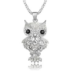 Owl Pendant Eyes made with Swiss cut Crytals. White body made with Swarovski Elements.