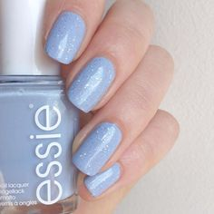 Soft and inviting, nothing says summer on the ocean like this sugar-sweet atlantic blue that stretches on and on. essie 'saltwater happy' with a touch of glitter brightens up any day.