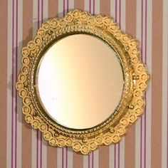 Decorative round 'golden' mirror to enhance any room. 49 x 49mm from The Dolls House Emporium
