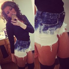 ombre denim bleached shorts. tucked in black top. knee-high black socks <3 adorable.