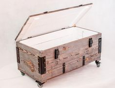 Grey wooden case made from old amunition boxes
