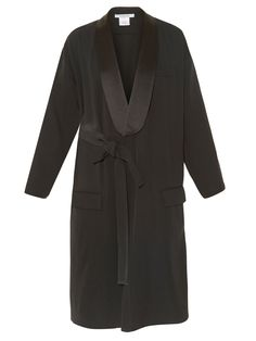 Givenchy channels an androgynous vibe for SS16, and this black cady coat is a sleek translation. It's cut to a loose shape that drapes elegantly over the body, and is lined at the lapels with tonal satin. Layer it over a classic white vest – it'ill look just as chic tied at the side of the waist as it will left open.