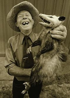 This makes me smile.  IDK if it's the grin of the possum or the grin of the feller....but something about it just tickles me! hahahaha!!!