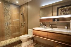 #AvalonInteriors: #wetstyle vanity & mirror, wood porcelain tile, pebble stone inserts and floor