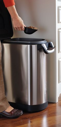 A convenient alternative to bulky bags of dog food, this sleek simplehuman ® Airtight Pet Food Storage keeps food fresh and out of reach of prying pets.