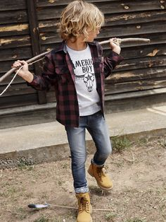 basic jeans-and-tee look up a notch with a flannel shirt and rugged boots for your rough and tumble little boy!