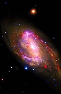 NGC 3627: The spiral galaxy NGC 3627 is located about 30 million light years from Earth. This composite image includes X-ray data from NASA's Chandra X-ray Observatory (blue), infrared data from the Spitzer Space Telescope (red), and optical data from the Hubble Space Telescope and the Very Large Array Telescope (yellow). The inset shows the central region, which contains a bright X-ray source that is likely powered by material falling onto a supermassive black hole.