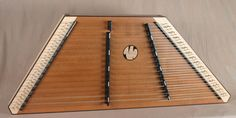 2012 - #1599 - A James Jones 16/15 Custom Hammered Dulcimer with a Birdseye Maple frame and pin panels, Redwood SB, Maple bridges made black and Wenge trim.