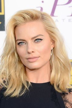 Margot Robbie's beachy waves and muted lip.