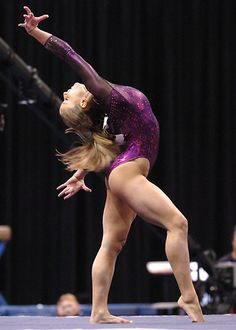 I've always loved this pose from Alicia Sacramone's routine.  Her hair block her left arm, but it's still a gorgeous shot.